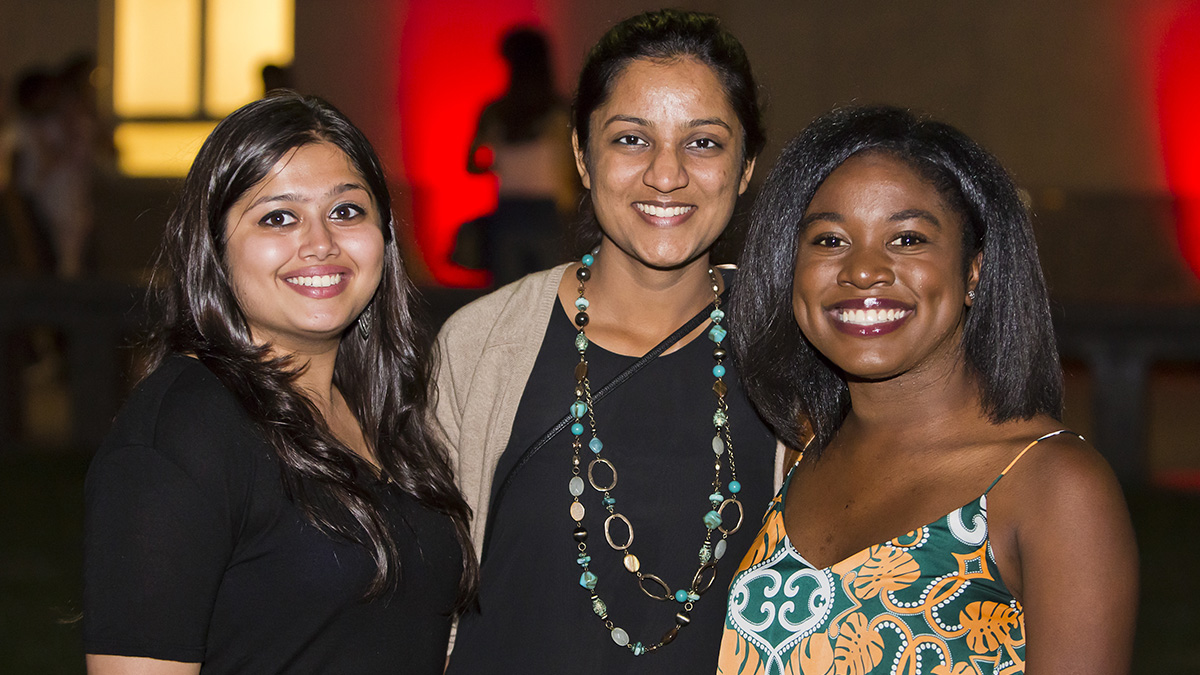 Three women smiling at a camera